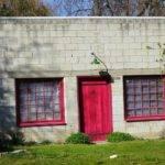 Cheap Cinder Block Model House Has Red Wooden Door
