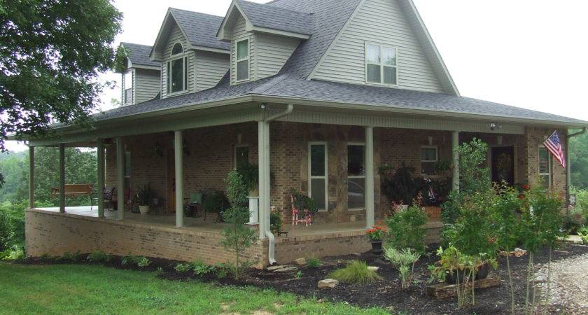 Dormered Farmhouse Green Metal Roof Wrap Around