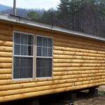 Faux Log Cabin Siding Placed Mobile Home