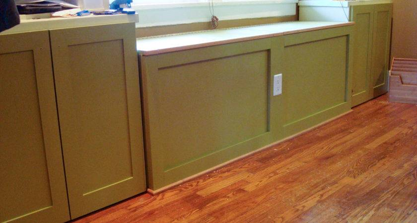 Green Painted Storage Cabinet Door Under Window