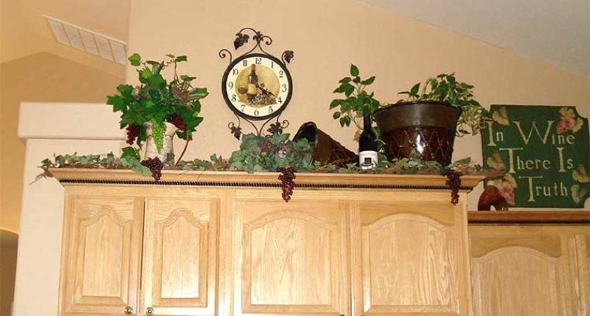 Lady Goats Decorating Above Kitchen Cabinets