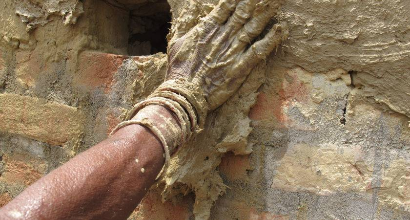 Mothers Applying Mud Plaster Section Fired