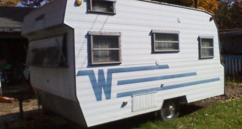 Rusty Glider Winnebago Travel Trailer