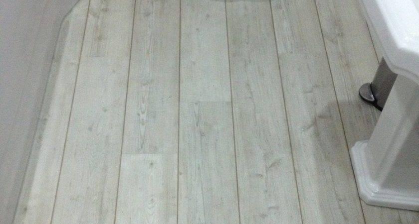White Vinyl Flooring Bathrooms Ideas