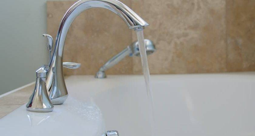 Woman Turning Off Hot Water Bathtub Faucet Bathroom